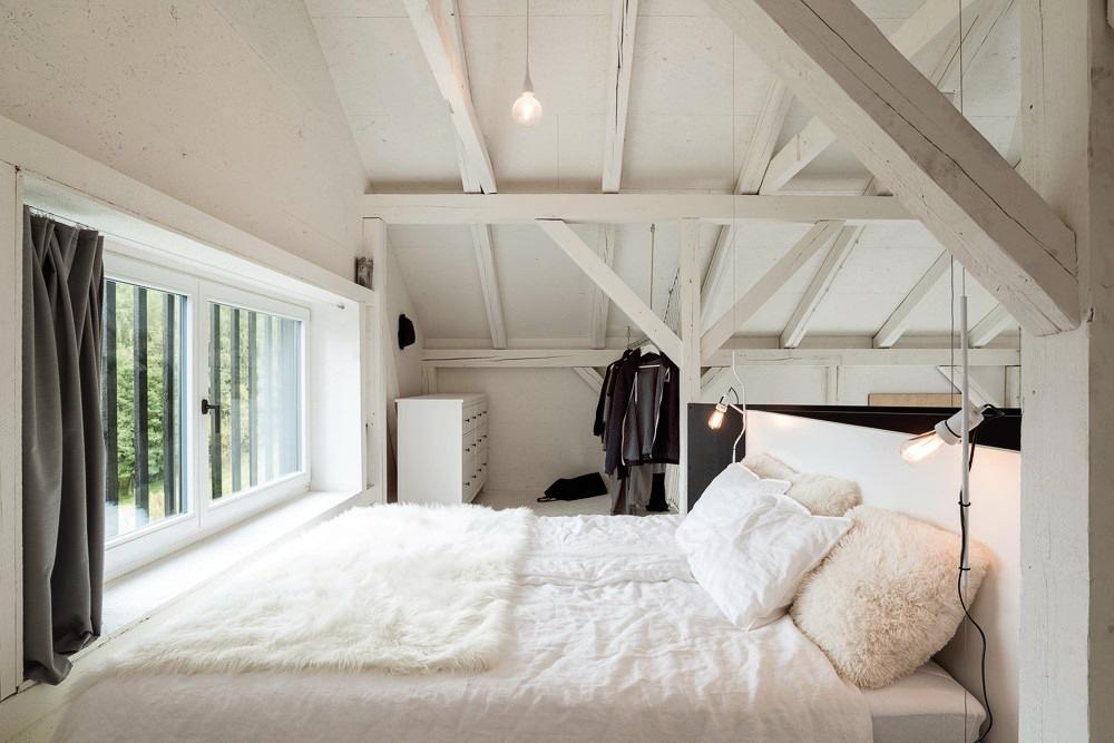 Un viejo granero reconstruido en un hogar de estilo escandinavo 15