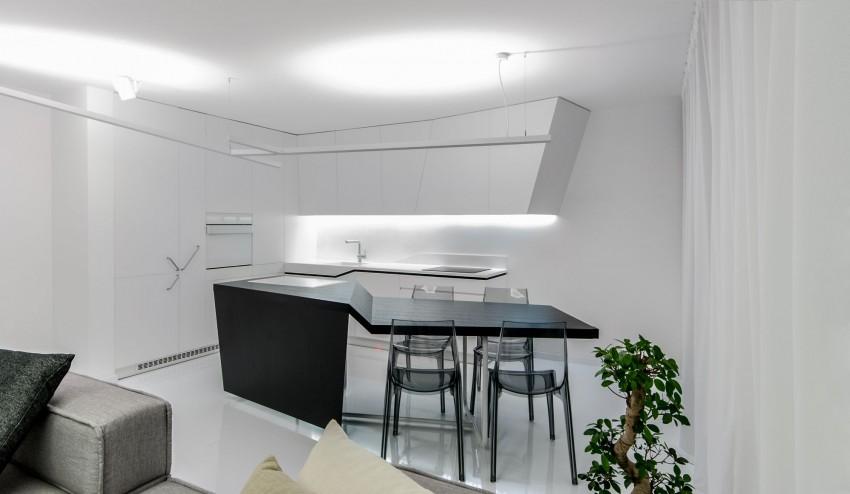 Apartamento minimalista con un diseño fresco y un ambiente acogedor 7