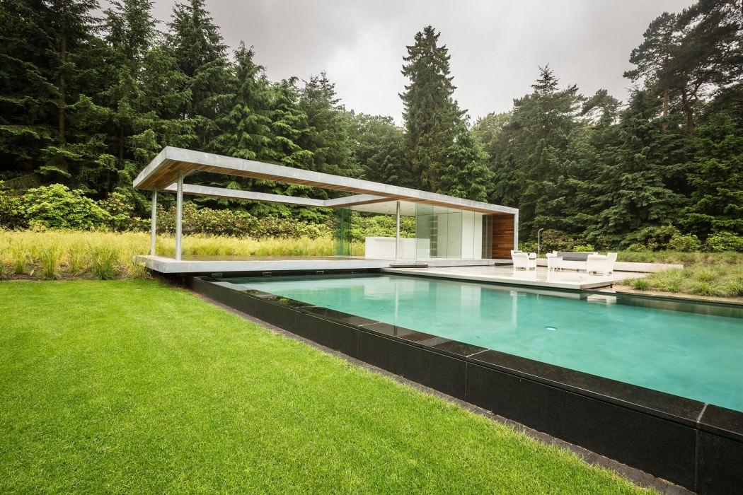Casa de campo moderna y transparente con una galería para el coche 15