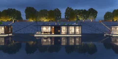 casas flotantes en el río Danubio con fachada de cristal
