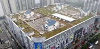 casas levantadas encima de edificios 16