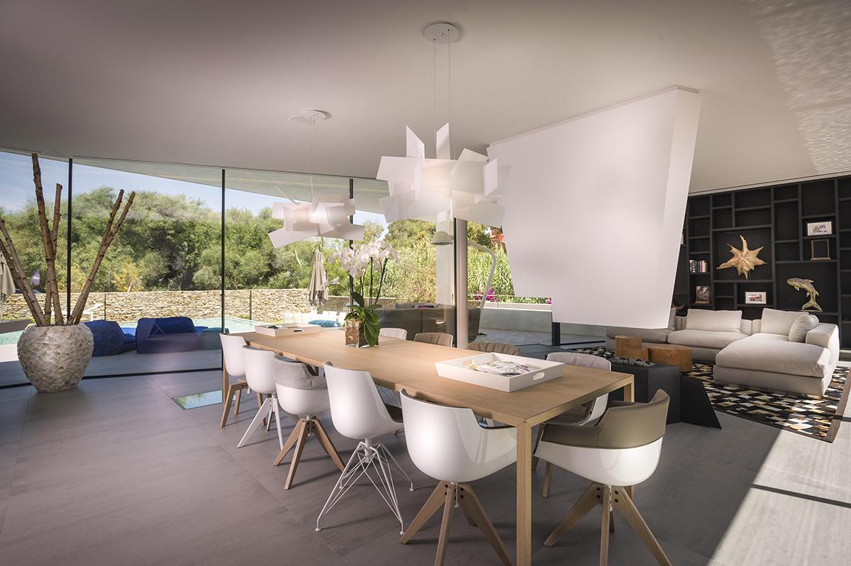 Casa moderna a orillas del Mediterráneo con muro invertido en el salón
