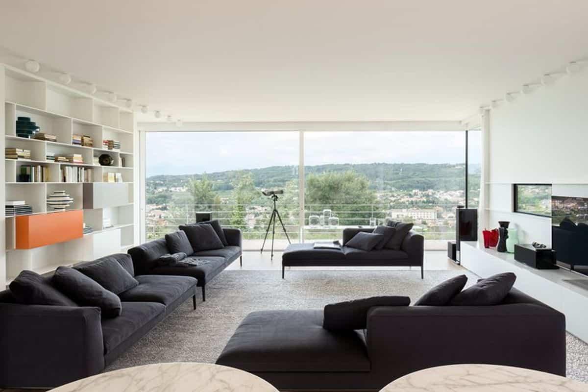 residencia moderna en Montebelluna - salón vistas al jardín