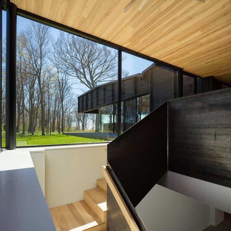 casa techo con forma de mariposa 10