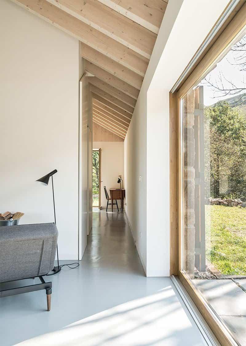 casa de piedra con interior contemporaneo 8